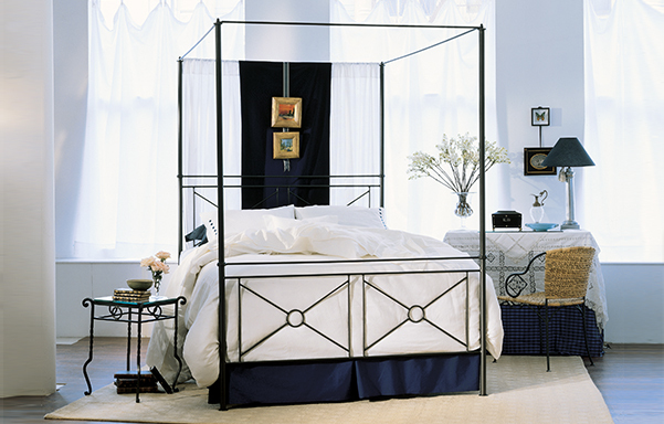 Campaign queen canopy bed - high footboard