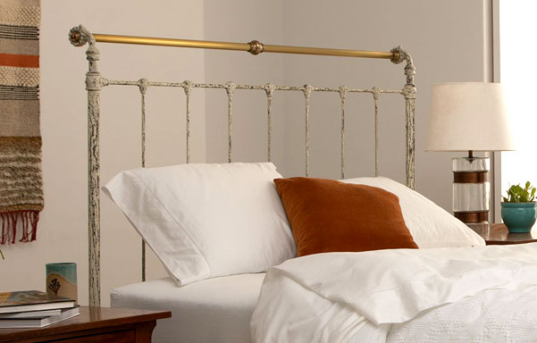 Iron & Brass queen bed close-up in Vintage White