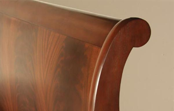 Stratford sleigh bed flame mahogany finish detail