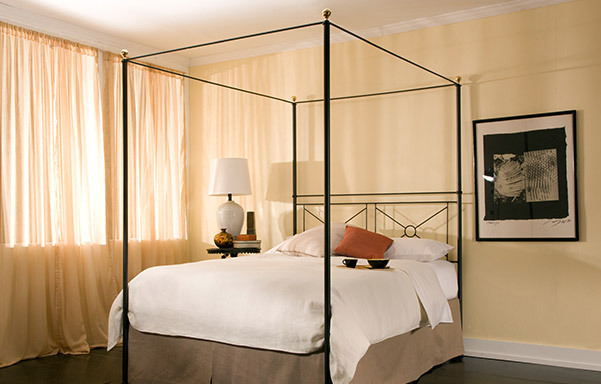 Campaign open footboard canopy bed room view