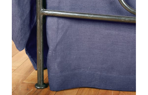 Breton trundle bed forged iron footboard detail