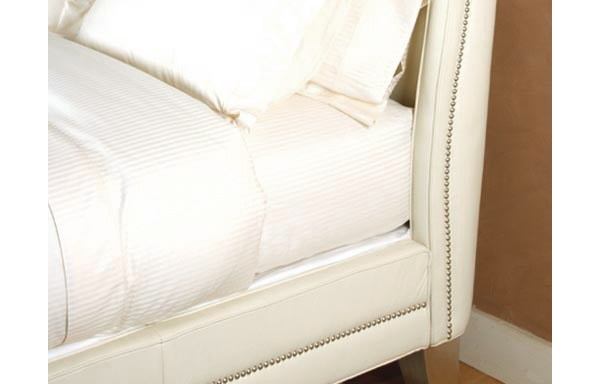 Wing white leather upholstered rail details