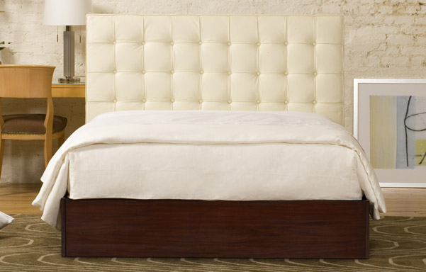Newhouse queen bed in white leather room setting