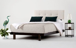Alana bed in dark brown mahogany with natural white upholstered headrest